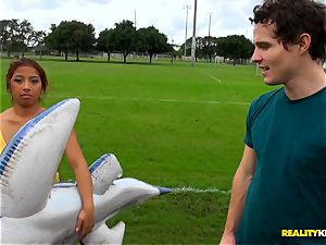 Monica Santhiago inserted in her pussy on an inflatable shark