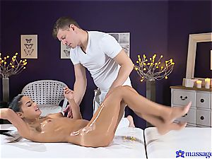 Exotic oiled stunner gets orgasmic massage session