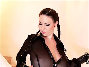 brown-haired undresses of her raincoat and parades her tits