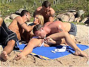 kinky Lea fuckin' three men on the beach