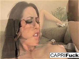 Capri enjoys to use various toys on her moist cock-squeezing gash