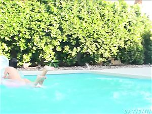 Catie Minx toying in the pool
